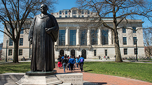 William Oxley Thompson statue in front of Thompson Library with students walking by
