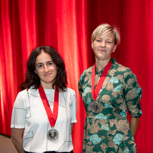Jody Patterson, Endowed Chair of Art History, and Carmen Winant, Endowed Chair of Studio Art, proudly stand on stage with their Roy Lichtenstein Foundation medals.