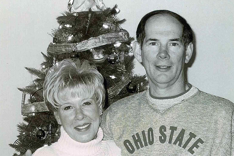 Barry Pfaff with his arm around his wife, Carol, posing for a Christmas picture.